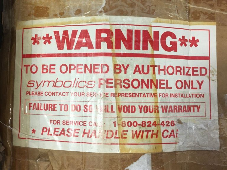 Warning: To be opened by authorized Symbolics personnel only. Please contact your service representative for installation. Failure to do so will void your warranty. For service please call 1-800-824-426x. Please handle with care.